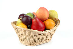 Basket of Fruit. Basket filled with an assortment of fruit Stock Photo