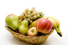 Basket with fruit. Fruit in the basket and onto white background royalty free stock image