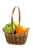 Basket with fruit. Apples and orange Stock Images