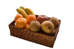 Basket with fruit. On the white background Stock Photos