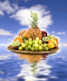 Basket of fruit. On sky and water Royalty Free Stock Photography