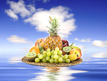 Basket of fruit. On sky and water Stock Photo