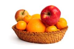 Basket with fruit. Isolated on white Stock Photos