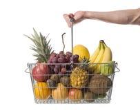 Basket of fruit. Holding a shopping basket of fruit Royalty Free Stock Photo