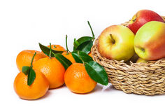 Basket of fruit, apples, leaf clementines Royalty Free Stock Photos