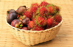 Basket of Fruit. Organic rambutan and mangosteen Thai fruits in Bamboo Basket Royalty Free Stock Images