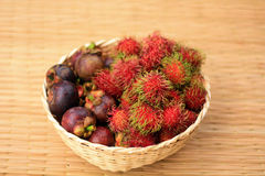 Basket of Fruit. Organic rambutan and mangosteen Thai fruits in Bamboo Basket Stock Photography
