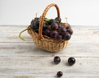 Basket with fruit plum, grapes, apple, pear. stock image