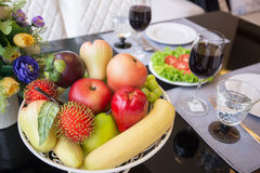 A basket of fruit on table set Royalty Free Stock Image