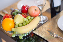 A basket of fruit on table set Royalty Free Stock Photo
