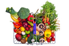 Basket fruit and vegetables isolated on white. Photo of a wire shopping basket full of fresh fruit and vegetables, shot from above and isolated on a white Stock Photography