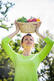 Basket of fruit and vegetables over the head Royalty Free Stock Images