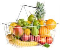 Basket of fruit on white. Shopping basket full of fresh fruit isolated on white background Royalty Free Stock Photography