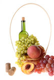 Basket with fruit and a wine bottle Stock Image