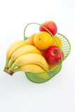 Basket of fruits. A basket of bananas, oranges and apples Royalty Free Stock Photography