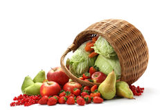 Basket with fruits. Basket full of fresh fruits and vegetables Stock Photos