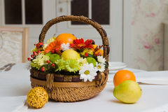 Basket with fruits and flowers Stock Image
