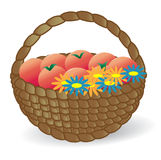 Basket with fruits and flowers. In the background Royalty Free Stock Image