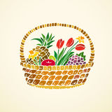 Basket with fruits and flowers Royalty Free Stock Image