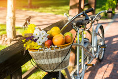 Basket with fruits and flowers. stock photo