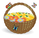 Basket with fruits and flowers, Butterflies fly around Stock Photography