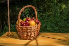 Basket with fruits and grapes Stock Photo