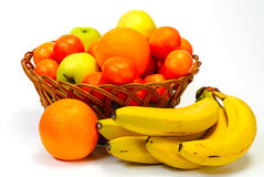 Basket with fruits, isolated on white background Stock Photography