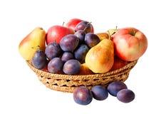Basket with fruits isolated on white background Stock Photos