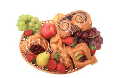 Basket with fruits and pastries. Royalty Free Stock Photography