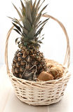 Basket with fruits - pineapple and kiwi Royalty Free Stock Photos