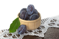 Basket with fruits plums Stock Photography