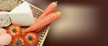 Basket with fruits, vegetables, eggs, cheese and bread biological Stock Images