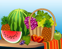 Basket and fruits watermelon grape peaches Royalty Free Stock Photos