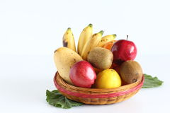 Basket of fruits on white Stock Images