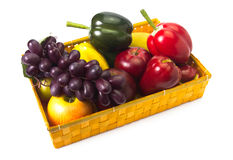 Basket with fruits on white Stock Images