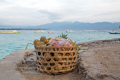 Basket full of ananas and tomatoes in the harbor exported from Gili Meno Indonesia Stock Photo