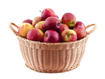 Basket full of apples. Isolated on white stock image