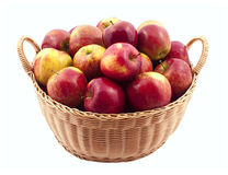 Basket full of apples. Isolated on white royalty free stock image