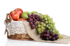 Basket full of apples and juicy grapes Stock Photography