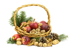 Basket full of apples, nuts, cinnamon Royalty Free Stock Photos