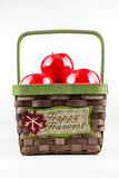 Basket full of apples. A wicker basket full of autumn apples Stock Image