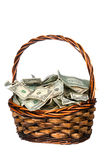 Basket full of cash. A wicker basket with handle holds a pile of cash.  Good for most financial inferences including investment, retirement, savings, wealth and Stock Photo