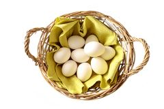 Basket full of chicken eggs fresh from the stall for a Happy Easter isolated on a white background, high angle view from above stock image
