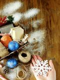 Basket full of Christmas attributes and present boxes Royalty Free Stock Image