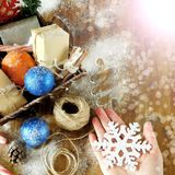 Basket full of Christmas attributes and present boxes. Christmas composition Stock Photo