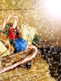 Basket full of Christmas attributes and present boxes Stock Image