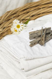 Basket full of clean freshly washed grandmother's linens Royalty Free Stock Photo