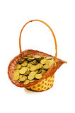 Basket full of coins isolated Stock Image