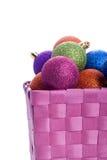 basket full of colorful christmas balls Royalty Free Stock Image