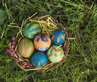 Basket full of colorful Easter eggs at meadow Stock Photography